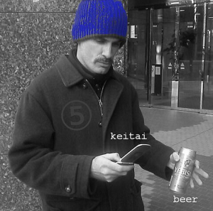 mike smith with phone and beer